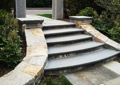 Landscape materials, crushed stone, loam, soil, garden compost, compost, Granite step, granite steps, Granite Custom Fabrication, Stone steps, Custom Stone fabrication, G.I. Stone, New Hampshire stone, Massachusetts stone, Maine stone, New Hampshire granite, Massachusetts granite, Maine granite, Vermont granite, Granite, Custom granite, Granite step, Natural Stone, Stone patios, paver driveway, paver walkway, Natural stone, back yard patio, outdoor living area, Concrete pavers, Building stone, Stone veneer, Wall stone, Veneer, Thin stone veneer, Retaining walls, Blue stone, Clay brick , Granite benches, Granite mantel, Granite post, Granite mailbox, Granite light post, Cobble stone, Cobbles, Granite edging, Granite treads, Bluestone treads, Granite pavers, Pavers, River rock, Veneer, Natural stone flagging, New England field stone, Field stone, Round field stone, Granite pool coping, Bluestone pool coping, Outdoor stone fireplace, Stone fire pit, Indoor stone fireplace, stone veneer, Stone hearth, Concrete sand, Stone dust, ¾ crushed stone, 1 ½ crushed stone, Screened loam, bark mulch Merrimack, bark mulch Merrimack NH, Bark mulch Nashua NH, Bark mulch Bedford NH, Bark mulch NH, drafting services, Custom Stone fabrication, landscaping supply store, bark mulch delivery, retaining walls, concrete pavers, belgard pavers, techo bloc pavers, ideal pavers